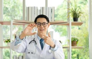 Asian doctor give consult online via video call photo