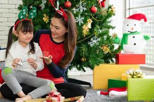 Asian mother and child celebrate Christmas festival together photo