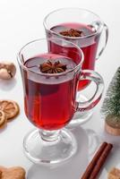 Hot red mulled wine isolated on white background with christmas spices photo