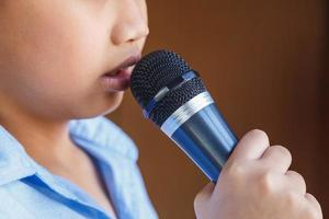 Boys with microphone learn to sing photo