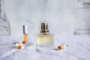 Golden perfume and perfume bottles on white background photo
