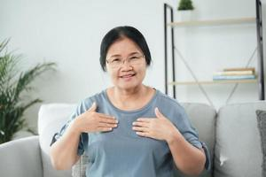 Deaf disable woman use Sign Language to communicate with other people. photo