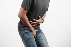 Man hold his stomach and crotch suffering from Diarrhea, incontinence. photo