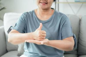 Deaf disable woman use Sign Language to communicate with other people photo
