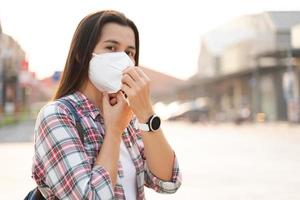 Woman wearing N95 face mask to protect PM2.5 and Covid19 virus photo