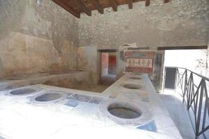 Commual Kitchen in Ancient City Pompei Italy photo