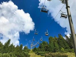 Chairlift for hikers in the summer season photo