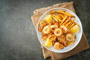 Calamari - fried squid or octopus with fries photo