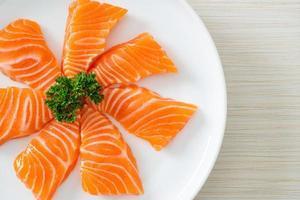 Fresh Salmon Raw Sashimi on plate photo