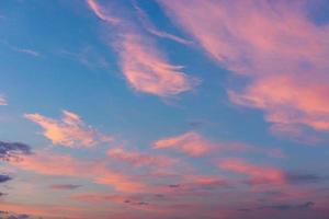 Real majestic sunrise sundown sky background with gentle clouds photo