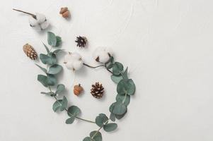 Autumn Mock up of Eucalyptus leaves and cotton plant photo