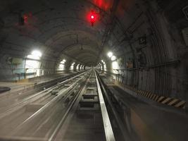 Underground subway railway tunnel, with neon lights photo