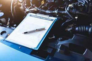 Clipboard with car insurance claim form for customer maintenance photo