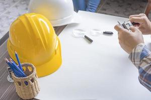 Construction engineer measuring with vernier caliper photo