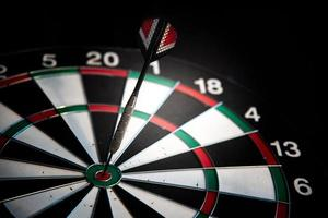 Darts arrows in center target. Business and leisure concept photo