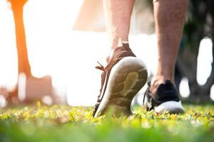 Sport man warm up to jogging at park. Outdoor exercise concept photo