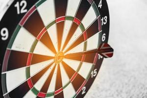 Dart board and arrow in middle. Business and success concept photo