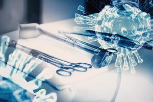 Primer instrumento de cirugía y herramientas estériles con virus foto