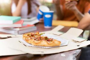 Pizza in delivery box with people friendships party background photo