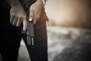 Robber holding gun for ready to murder steal moneys photo