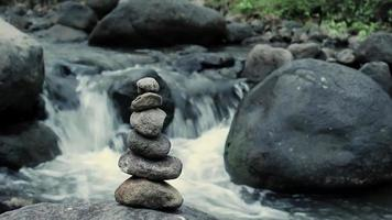 Pyramids of stones arranged on river video