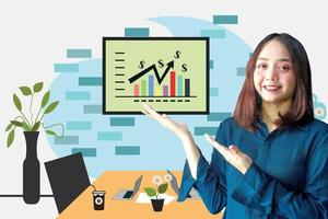 Cheerful businesswoman presenting infographics at the meeting room photo