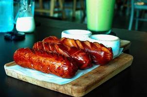 Tasty grilled german suasage photo