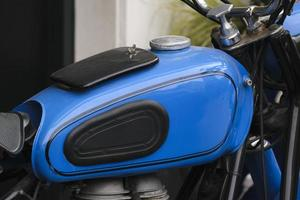 Closeup shot of a cool blue motorcycle's gas tank photo