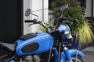 Closeup shot of a cool blue motorcycle parked outdoors photo