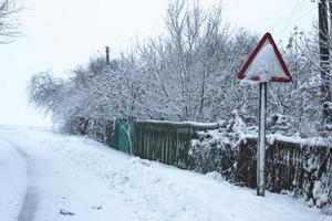 Empty snowy road in winter photo