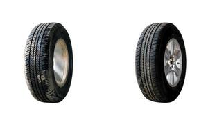 Side view of car tire with alloy wheel isolated on white background photo