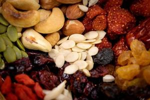 Closeup group of various types of whole grains and dried fruits photo