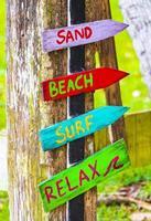 Sand beach surf relax colorful directional arrows Ilha Grande Brazil. photo