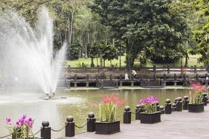 Beautiful fountain in the park in the Perdana Botanical Garden. photo