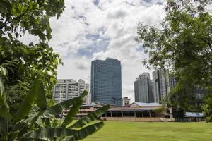Huge skyscrapers behind tropical nature, Kuala Lumpur. photo