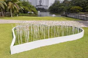 Large white decorative heart with flowers in Perdana Botanical Garden. photo