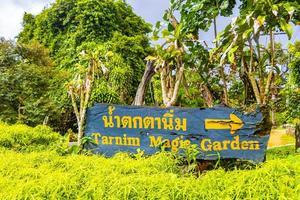 Direction sign Tarnim Magic Garden and Waterfall Koh Samui Thailand. photo
