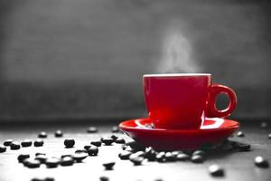 Red cup coffee with smoke and coffee bean photo