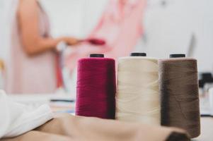 Closeup of colorful thread with fashion designer photo