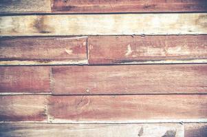 Primer plano de una vieja textura de tablón de madera marrón rojo foto