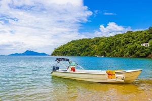 Boat at Praia de Palmas beach, Ilha Grande, Brazil photo
