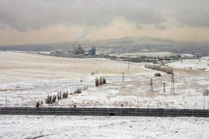 Snow landscape, a cement factory and industrial zone photo