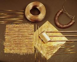 Background samples of copper plate, copper bars and copper shavings photo