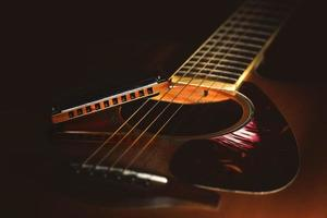 Detail of a Acoustic guitar with country blues harmonica photo
