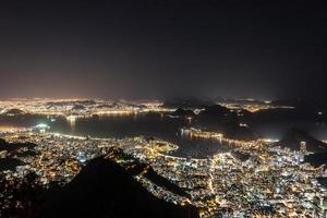 City lights seen from the top of the Corcovado hill in Rio de Janeiro, Brazil photo