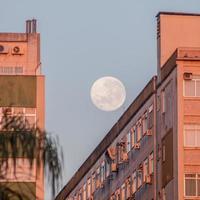 Full moon over a building on Botafogo beach in Rio de Janeiro, Brazil photo