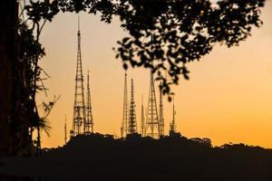 Silhouette of communication antennas on the Sumare hill, in Rio de Janeiro, Brazil photo