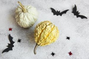 Top view of Halloween crafts,  pumpkins, bat and spiders photo