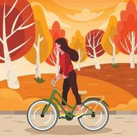 Woman Rides a Bike at Park in Autumn vector