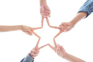 Hands in form as star shape on isolated white background photo